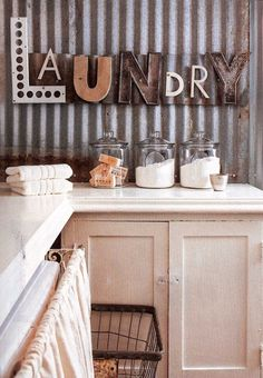 Fabulous laundry room with LAUNDRY repurposed letters as wall decor.....Does…