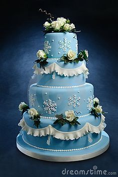 Romantic blue wedding cake decorated with hand made frosted sugar roses, snow cristals and sugar cristals.
