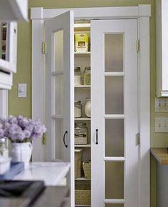 Great pantry door in the kitchen | Image source: bhg.com