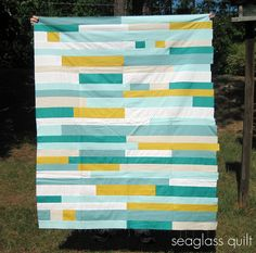 """""""I wanted to make a quilt for my living room entirely out of solids. I used Kona Aqua, Kona Curry, Essex Linen Natural, Kona Sage, white and Moda Crossweave Ocean. I still have not decided what I am going to do for the quilt back."""" three_little_pumpkins"""