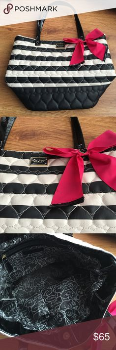 Betsey Johnson Tote Bag This bag is awesome! Roomy and in excellent condition!! Black and white and hot pink!! Betsey Johnson Bags Totes