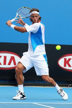 Feliciano Lopez of Spain plays a backhand