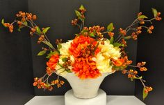 Fall 2014 Season Floral: Yellow and Orange Mums and berry branches on white crackled ceramic basket vase. Original design and arrangement by http://nfmdesign.synthasite.com/
