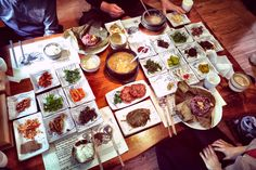A table bent with the weight of food - that's Korean side dish culture for you https://bibimbites.com/korean-food/a-table-bent-with-the-weight-of-food-korean-side-dish-culture/