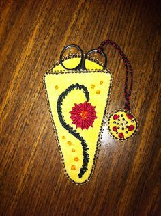 Scissors case. Beads, embroidery on tanned deer hide. Made by Rose Berens. Bois Forte Band of Ojibwe.