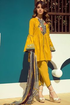 offer by at Zellbury Clothing. Embroidered Neckline on a Printed Yellow Shirt with a dyed Cambric Trouser is best for Office Wear and University Wear. This casual chic dress gives a young look to all the girls who wear this dress. Pakistani Fashion Casual, Pakistani Dresses Casual, Pakistani Dress Design, Pakistani Frocks, Pakistani Lawn Suits, Punjabi Suits, Salwar Suits, Indian Fashion, Simple Dresses