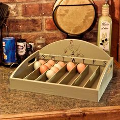The large box has seven sections each labelled with the day of the week that the eggs are laid, and includes a handle on each side. It will hold approx 35 average-size eggs.