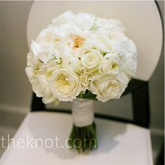 The bridal bouquet will be ivory garden roses, peachy spray roses, white lisianthus with some green buds, and white tulips wrapped in lace from the bride's dress with the stems showing.