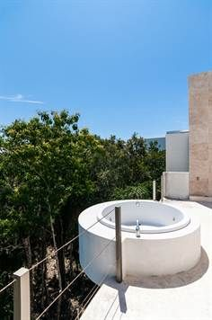 For Sale: 3-bdrm villa in a Riviera Maya resort community, with a pool and an incredible rooftop terrace $575k