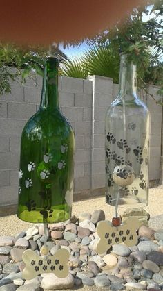 Materials: recycled wine bottle, acrlylic water proof paint, leather cord, wood bone, wood ball