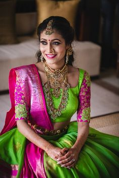 Looking for Mehendi bridal portrait in green and pink lehenga and layered jewellery? Browse of latest bridal photos, lehenga & jewelry designs, decor ideas, etc. on WedMeGood Gallery. Half Saree Designs, Blouse Designs, South Indian Bride, Indian Bridal, Parrot Green Saree, Green Lehenga, Anarkali Lehenga, Indian Blouse, Indian Wear