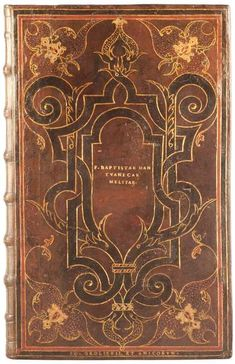 Jean Grolier is one of the great figures of book collecting and bookbinding history. He served France as a diplomat in Italy, and returned to his native country with new designs for bindings, which he commissioned in Paris in the early sixteenth century.  Author:	Baptista, Mantuanus, 1448-1516  Title:	Omnia opera.  Published:	 Bologna: Beneditto Faelli, 1502.  Location:	Rare Books (Ex)  Call number:	Oversize 2949.146.3q  Spine height:	33 cm