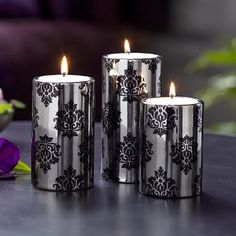 "Forbidden Romance Large Tealight Trio Elegant patterned ceramic holders have the look of a pillar but hold a tealight inside. Tealights sold separately. One of each height: 6""h, 5""h, 4¼""h. Giftable packaging"