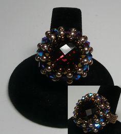 Hola Burgundy  Design by Pencio   Swarovski Burgundy Rivoli with Dorado 2X and Burgundy AB2X bicones with Bronze Pearls with fire polished and miyuki beads