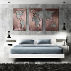 Stunning brushed copper oversized three panel map of the world.