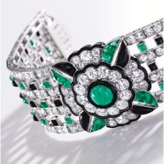 Platinum, Diamond, Emerald, Enamel and Onyx Bracelet, Mauboussin, France, 1925 - Sotheby's