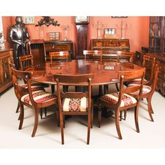 A beautiful bespoke contemporary flame mahogany Regency style Jupe dining table with a set of 10 dining chairs. Buy Dining Table, Extendable Dining Table, Round Dining, A Table, Dining Chairs, Expanding Round Table, Beam Structure, Mahogany Furniture, Table And Chair Sets