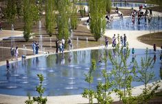 Playful water feature at Madrid Rio Park beach.