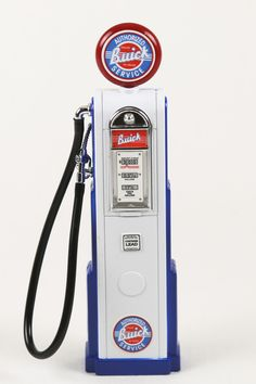 """Accurately styled after the historical originals, this diecast model gas pump adds life to any 1:18 scale model car display. The computing """"digital"""" pump has vintage logos, flexible hoses, and detacha"""