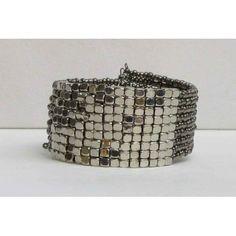 Bracelet extensible de couleur argent et gris.  Aussi disponible en noir.