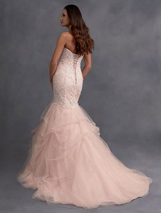 A Full Length, Modern Wedding Dress with Strapless, Sweetheart Neckline, Lace, Dropped-Waist Bodice, and Tulle Pick-Up Skirt