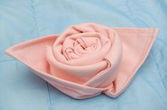 How to Make a Rose out of a Cloth Napkin.
