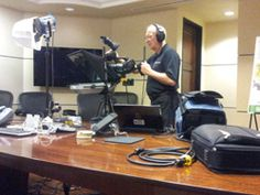 www.psavideo.com production activity with Earl setting up for the shoot in our client's offices