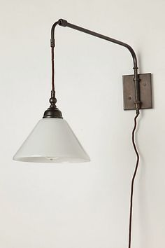 A reminder of the sleek utility of early industrial designs, this elegant handmade fixture has a minimal footprint and a timeless silhouette.