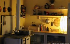 Wood stove from the '50s and a modern IKEA Varde shelf, plus second hand IKEA Bonde furniture (no longer available) Erbaviola.com - Grazia Cacciola - http://www.erbaviola.com/2014/02/10/volo-su-una-domenica-disorganizzata.htm
