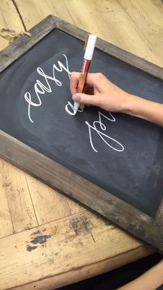 Chalkboard Calligraphy - use scissors to sharpen your chalk, Magic Erasers remove all smudges, write each letter individually, go back over anywhere your pen would've moved downward and thicken the line, upward strokes should remain thin