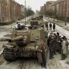 the_ww2_archives A Column of Soviet ISU-122 (Samokhodnaya Ustanovka 122) self-propelled guns during a brief lull in the fighting in a suburb of Berlin, May 1945.  Photographer - Roman Lazarevich Karmen (Рома́н Ла́заревич Карме́н)  Many ISU-122s were often fielded in mixed units with the ISU-152, despite attempts by Red Army Commanders to avoid this within one tank regiment or at least a tank brigade. There were two main reasons for this – the first being that two sets of calculations would…