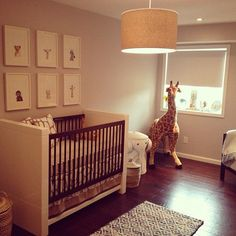 What a fun nursery! I love the animal prints on the wall and look there's our Oilo crib bedding! /BR @obs form Nursery