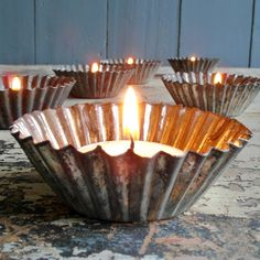 Old muffin tins - the tea light candle looks so gorgeous in these tins