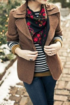 Floral scarf with black and white stripes.  Beige blazer is just the icing