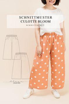 Unser Schnittmuster Culotte Bloom ist eine lässig geschnittene High-Waist-Hose mit weiten Beinen und elastischem Bund – modern aber zeitlos. Bequem wie eine gemütliche Hose, elegant und schwungvoll wie ein Rock. Style deine Culotte Bloom lässig und sportlich mit einem engen Shirt oder cropped Top – oder etwas schicker mit einer weißen Bluse und hochgekrempelten Ärmeln. Ob mit Sneakers, Ballerinas oder High Heels, kreiere vielseitige Looks mit deiner neuen selbstgenähten Lieblingshose.