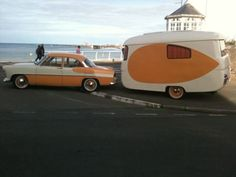 Peaches and Cream car with matching camper!