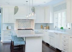 Off-white kitchen with turquoise accents.  Profile Cabinet.: