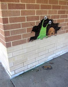 Found yet another cozy hangout! This one's in Hilton Elementary School, Brighton, Michigan and comes with its own hound dog. (October 11, 2013) - street art by David Zinn