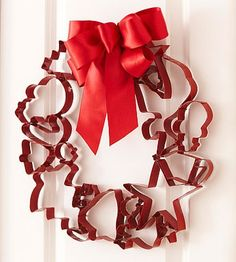 Cookie cutter wreath for the kitchen; cute way to show off my cookie cutters. Or, make one only with gingerbread men cookie cutters?