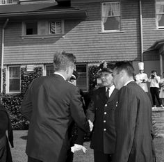 Weekend in Newport, Rhode Island: President Kennedy with police officer at Hammersmith Farm - John F. Kennedy Presidential Library & Museum26 September 1961