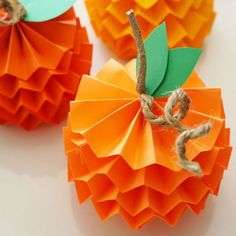 Pumpkins are ubiquitous during Halloween season. Do something fresh and help your kids make 'em out with just colored paper, tape, and glue. Bonus: These will look super-cutearound your house.