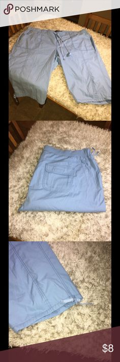 Gloria Vanderbilt Light Blue Capris Size 20W Light blue casual Capris.  Flat front waistband.  Back waistband is knot covered elastic band.  Accent tie at waist and hemline.  Size 20W.  Gloria Vanderbilt.  Excellent condition.   Important:   All items are freshly laundered as applicable prior to shipping (new items and shoes excluded).  Not all my items are from pet/smoke free homes.  Price is reduced to reflect this!   Thank you for looking! Gloria Vanderbilt Pants Capris