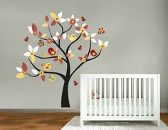 Kids tree vinyl wall decal with birds and garden daisy flowers and butterfly and ladybugs. $85.00, via Etsy.