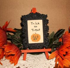 Primitive Halloween stitchery picture of a pumpkin and Trick or Treat. Found on Ebay.