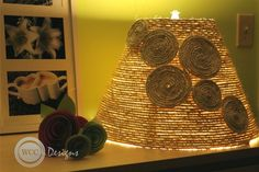 A fun lampshade made from coiling rope over a lampshade with a hot glue gun for adhesive.