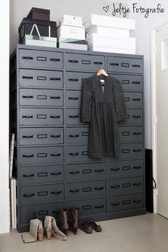 Grey accents: industrial grey metal closet in a feminine bedroom. Photography Jeltje Fotografie Styling Cleo Scheulderman