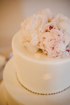 Pink Peonies on Wedding Cake | photography by http://tegaphotography.com