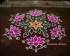 This is a dotted lotus kolam with interlaced dots Indian Rangoli Designs, Simple Rangoli Designs Images, Rangoli Designs Flower, Rangoli Border Designs, Rangoli Patterns, Border Embroidery Designs, Rangoli Ideas, Rangoli Designs With Dots, Flower Rangoli