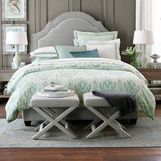 Stools at the foot of the bed to match the headboard