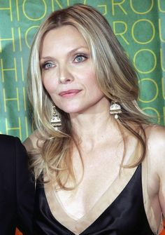 Michelle Pfeiffer Lookbook: Michelle Pfeiffer wearing Layered Cut (1 of 11). Michelle Pfeiffer wore her hair in a center-parted layered 'do at the Fashion Group International Night of Stars.